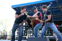 Former American Idol finalist Josh Gracin, left, gets down with band members during the Crazy White Boys Tour concert June 18 at Iron Horse Park.
