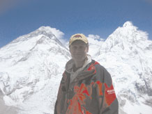 Lt. Col. Peter Solie, Air ForceSpace Command Space Safety Division chief, acclimates while standing at Mount Pumori Advanced Base Camp with the Mount Everest summit pyramid over his left shoulder. Colonel Solie reached the summit May 17. (courtesy photo)