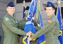 Incoming 50th Operations Group Commander, Col. John Shaw (right) accepts the group guidon from the 50th Space Wing Commander, Col. Wayne Monteith, during the group's change of command ceremony July 1st. (U.S. Air Force Photo/Dennis Rogers)
