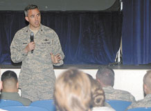 Col. Stephen N. Whiting, 21st Space Wing commander, spoke to Airmen July 14 for Wingman Day, saying that part of the wing's mission is to develop and care for warrior Airmen. He asked Airmen to pay attention to safety this summer, a time when mishaps, injuries and deaths spike Air Force wide. Colonel Whiting also asked Airmen to pay attention to each other and to be good wingmen, especially in noticing signs that someone is struggling in their work or personal lives. (U.S. Air Force photo/Dennis Howk)