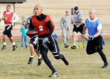 Gabe Moreno, 50th Force Support Squadron, gains yardage during the flag football championship game here Oct. 21. The 50th Mission Support Squadron narrowly defeated the Space Innovation and Development Center 20 to 19. (U.S. Air Force photo/Dave Ahlschwede)