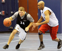 Aaron Kirchoff, 50th Comptroller Squadron/Force Support Squadron, attempts to drive around Maurice Gale, 11th Space Warning Squadron, during the second half of 50 CPTS/FSS' 51-28 intramural basketball victory Jan. 13 at the fitness center. (U.S. Air Force photo/ Dennis Rogers)
