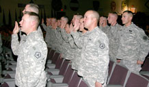 Thirty-one Soldiers with the 4th Engineer Battalion recite the noncommissioned officer oath Dec. 10 during the battalion's NCO induction ceremony at McMahon Auditorium.