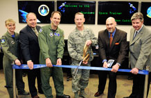 (from left to right) Lt. Col. Theresa Malasavage, 50th Operations Support Squadron commander; Patrick Phelps, Air Force Space Command Training, Exercises and Evaluation Division Headquarters chief; Col. John Shaw, 50th Operations Group commander; Col. Mike Mason, 50th Space Wing vice commander; Mr. Craig Divich, Sonalysts, Inc. principal analyst and Paul Eckert, Space and Missile Center, Space Training Acquisition Office. (U.S. Air Force photo/Dennis Rogers)
