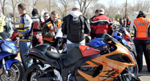 Photo by Kerstin Lopez.   Bikers conduct safety inspections on their motorcycles before participating in the group ride from post to the Garden of the Gods Park.