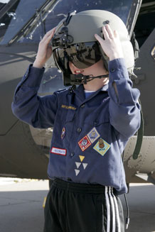 Russell Betterton, 9, tries on a flight helmet during the Fort Carson Cub Scouts' tour of an Army aviation facility and UH-60 Black Hawk at Butts Army Airfield April 12.