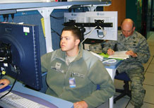 F.E. WARREN AIR FORCE BASE, Wyo.  —  Airman 1st Class Brian Hernandez, 4th Space Operations Squadron, demonstrates the Advanced Satellite Mission Control Subsystem and the Extremely High Frequency Antenna Calibration Facility for U.S. Strategic Command monitors March 22. Capt. William Klumpp, 4 SOPS, commanded the mission during the demonstration. (Courtesy illustration)