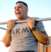 Sgt. Benjamin Frausto, cannon crewmember, 3rd Battalion, 16th Field Artillery Regiment,  2nd Brigade Combat Team, 4th Infantry Division, shows his intensity during the pull-up portion of the Physical Fitness Test for the 2011 Fort Carson Soldier of the Year competition May 10.