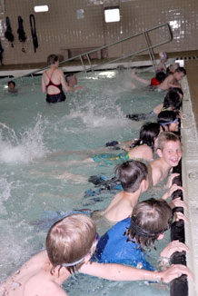 Children participate in a Family Fun Pool Party at the Indoor Pool Sunday.