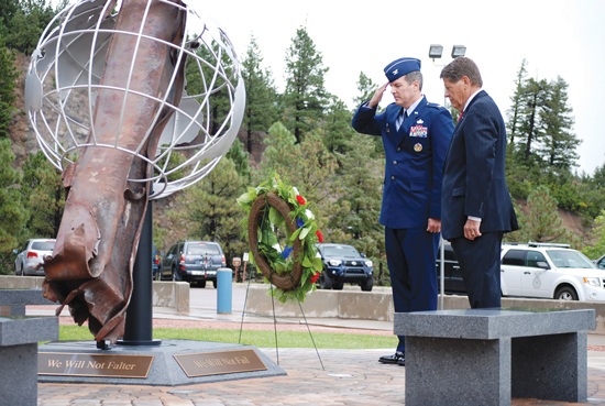 (U.S. Air Force photo/Michael Golembesky) CHEYENNE MOUNTAIN AIR FORCE STATION, Colo. — Col. Travis Harsha, 721st Mission Support Group and CMAFS installation commander, and Don Addy, chairman of the Colorado Thirty Group, place a wreath at the CMAFS 9/11 memorial Sept. 11. The memorial is located near the CMAFS entry and honors the men and women who lost their lives in the attacks, during the rescue efforts, and in the defense of the country.