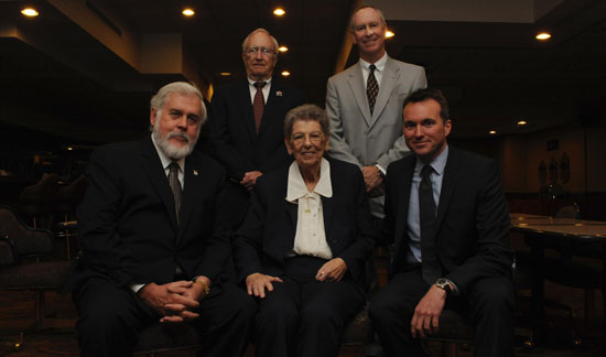 (U.S. Air Force photo/Airman 1st Class Pedro Mota)  From left, Glendale Mayor Jerry Weiers; retired Brig. Gen. Tom Browning, former 58th Fighter Wing commander from the early '90s; David Scholl, Fighter Country Partnership chairman of the board; and Acting Secretary of the Air Force Eric Fanning pose with Dorothy Rowe, the former 56th Comptroller Squadron financial analysis chief, middle, after Rowe's retirement ceremony Nov. 5 at Luke Air Force Base, Ariz. Rowe retired after a 70-year career, making her the longest-serving civil servant in the Air Force.