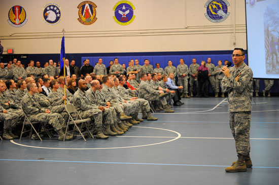(U.S. Air Force photo/Christopher DeWitt)  Col. Bill Liquori, 50th Space Wing commander, addresses Team Schriever during a Wingman Day commander's call here Dec. 3. Team Schriever members broke out into training sessions following the commander's call where they participated in interactive resiliency training.