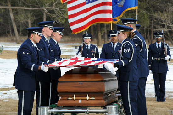 (U.S. Air Force photo/SSgt J. Aaron Breeden)  U.S. AIR FORCE ACADEMY, Colo. — Members of the High Frontier Honor Guard hold the flag that draped Capt. David Lyon's casket during his interment ceremony at the United States Air Force Academy cemetery Jan. 8. Lyon, 21st Logistics Readiness Squadron, was killed in action Dec. 27 after the enemy attacked his convoy in Afghanistan.