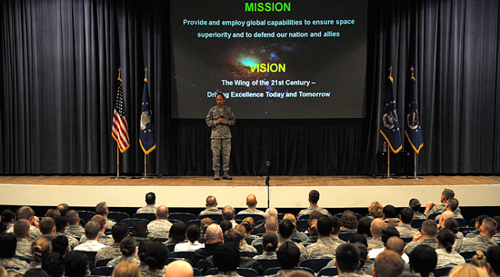 (U.S. Air Force photo/Robb Lingley)  Col. John Shaw, 21st Space Wing commander, presented the new wing mission, vision, priorities and objectives during his commander's call Jan. 9 at the base auditorium.