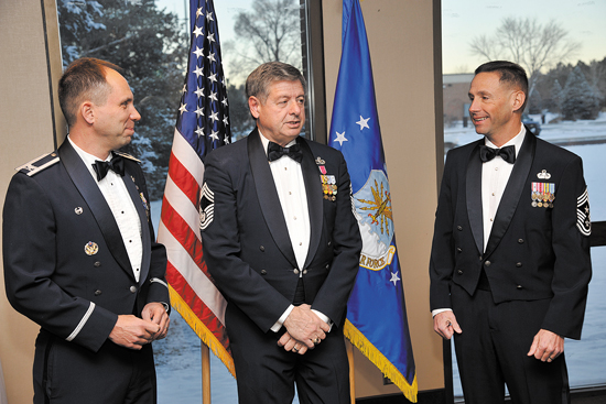 (U.S. Air Force photo/Dennis Howk) PETERSON AIR FORCE BASE, Colo. — (Left to right) Col. John Shaw, 21st Space Wing commander, former Chief Master Sgt. of the Air Force David Campanale, the 11th chief master sergeant of the Air Force, and Chief Master Sgt. Richard Redman talk before the annual award dinner Jan. 28. While Campanale was here, he visited the Airmen Leadership School and the Vosler NCO Academy to speak on past experiences pertaining to the future of the Air Force.
