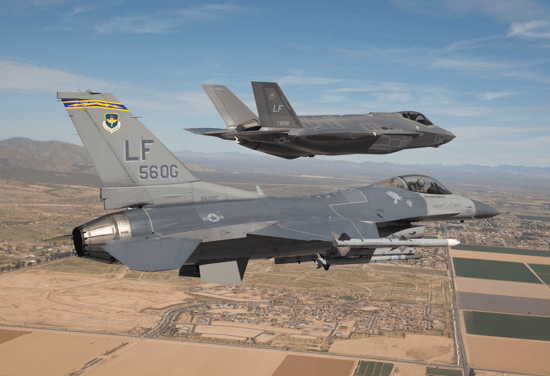 (U.S. Air Force photo/Jim Hazeltine) Maj. Justin Robinson flies the 56th Operations Group flagship F-16 Fighting Falcon as he escorts Luke Air Force Base's first F-35 Lightning II to the base March 10, 2014. The F-35 was flown by Col. Roderick Cregier, an F-35 test pilot stationed at Edwards AFB, Calif. Robinson is the 61st Fighter Squadron assistant director of operations.