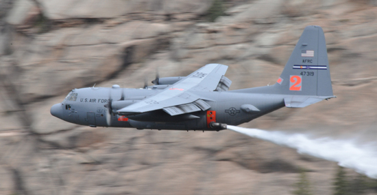 (U.S. Air Force photo/Master Sgt. Daniel Butterfield)  An Air Force Reserve Command C-130H assigned to the 302nd Airlift Wing drops a load of water during Modular Airborne Fire Fighting System certification near Hackett Mountain in Colorado May 18, 2014.