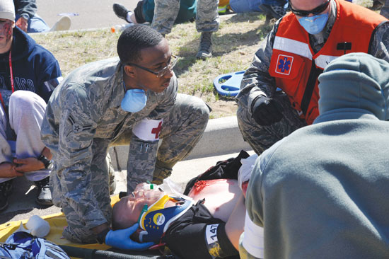 (U.S. Air Force photo/Robb Lingley) COLORADO SPRINGS, Colo. – A member of Peterson's medical team assists in the treating of simulated patient before transport to an area hospital. The event was part of a larger emergency response exercise called SkyFall, which consisted of a massive collaboration between multiple agencies throughout the Colorado Springs region.