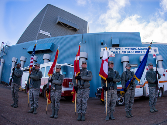 (Courtesy photo/Torben Bjerre)  THULE AIR BASE, Greenland -- Ceremonial Guardsmen from the Top of the World Honor Guard present the American, Canadian, Danish and Greenlandic flags prior to the Memorial Day Array-to-the-Bay Relay Run hosted by the 12th Space Warning Squadron here May 25. The run was held to honor Airman 1st Class Matthew Seidler and Capt. David Lyon, two fallen service members from the 21st Space Wing at Peterson Air Force Base, Colo.
