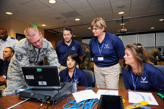 U.S. Air Force photo/Christopher DeWitt Staff Sgt. Charles Osbourne, 50th Space Communications Squadron, discusses network security with teachers (L-R) Naomi Edwards, Charlene Getz, and Darcie Starkfregoe during an Air Force Recruiting Service sponsored visit here, Aug. 5, 2014. The visit allowed tens of FIRST educators from across the nation to highlight the many STEM opportunities within the Air Force.