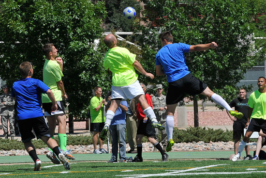 (U.S. Air Force Photo/Dennis Howk)  PETERSON AIR FORCE BASE, Colo. – Peterson Air Force Base and Schriever Air Force Base compete in soccer during the first-ever Tri-Wing Sports Challenge 27 Aug. hosted by Peterson Air Force Base. The Tri-Wing Sports Challenge was an opportunity for Airmen from Buckley AFB, Peterson AFB and Schriever AFB to strengthen the bonds of camaraderie in an environment outside of the workplace.