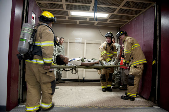 (U.S. Air Force photo/Michael Golembesky)  CHEYENNE MOUNTAIN AIR FORCE STATION, Colo. — First responders transport three simulated casualties to the Cheyenne Mountain medical facility within the secured complex using an industrial elevator. This was all part of the Vigilant Shield exercise Oct. 20-26 where CMAFS team members responded to real-world scenarios that could take place within the mountain.