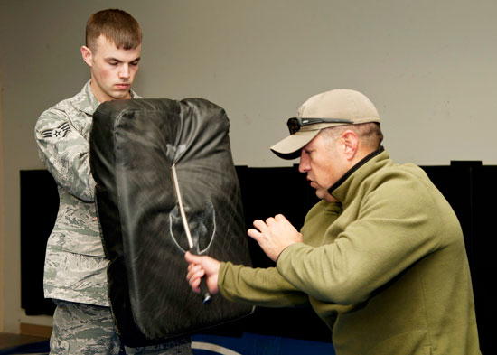 (U.S. Air Force photo by Senior Airman Tiffany DeNault)  PETERSON AIR FORCE BASE, Colo. – Staff Sgt. Morgan Buckley, 21st Security Forces Squadron patrolman, strikes a combative bag with an expandable baton during baton training Nov. 13, 2014. Members of the 21st SFS participate in yearly training for the secondary weapon, the expandable baton. It is one of a few ways to control of a situation and prevent unnecessary injuries to not only the subject but also themselves.