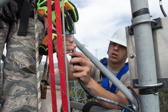 (Courtesy photo)  CHEYENNE MOUNTAIN AIR FORCE STATION, Colo. – Senior Airman Dakota Blankenship, 21st Communications Squadron cable and antenna maintenance technician, checks a cable to see if there is power where it should be 100 feet up a tower in July 2014. Those in the cable and antenna maintenance career field often climb towers or work in manholes to make sure connections aren't causing interference and are working properly.