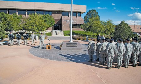 (U.S. Air Force photo by Senior Airman Tiffany DeNault) PETERSON AIR FORCE BASE, Colo. – Members of the 21st Security Forces Squadron participate in the closing ceremony at the fallen defenders vigil May 12, 2015. The Airmen took turns standing guard by the American flag and a display honoring the fallen defenders at the 21st Space Wing Headquarters building throughout the 12-hour remembrance. The vigil was one of several events recognizing Police Week, including a shoot house challenge, K9 military working dog demonstration, and a law enforcement memorial at Colorado Springs Memorial Park.