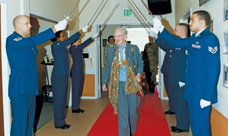 (U.S. Air Force photo by Tech. Sgt. Jared Marquis) THULE AIR BASE, Greenland – Her Majesty The Queen of Denmark Margrethe II is honored with a parade by the Thule Air Base Honor Guard during a visit here July 10, 2015. The Queen received a mission brief and toured several base facilities during her visit.
