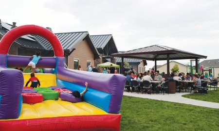 (U.S. Air Force photo by Senior Airman Tiffany DeNault) PETERSON AIR FORCE BASE, Colo. – The Chapel kicked off the July Fourth weekend with a community cook off for Team Pete members and their families at the Tierra Vista community center, July 2, 2015. The Chapel provided hot dogs, hamburgers, sides, games and bounce castles for approximately 200 people.