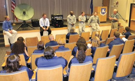U.S. Air Force photo/James Hodges For Inspiration and Recognition of Science and Technology program mentors listen to a briefing during a cyber-tech demonstration Tuesday, July 14, 2015 given by the 50th Space Communications Squadron during a tour of Schriever Air Force Base, Colorado. FIRST is a nonprofit that was founded in 1989 to inspire an appreciation of science and technology in young people.