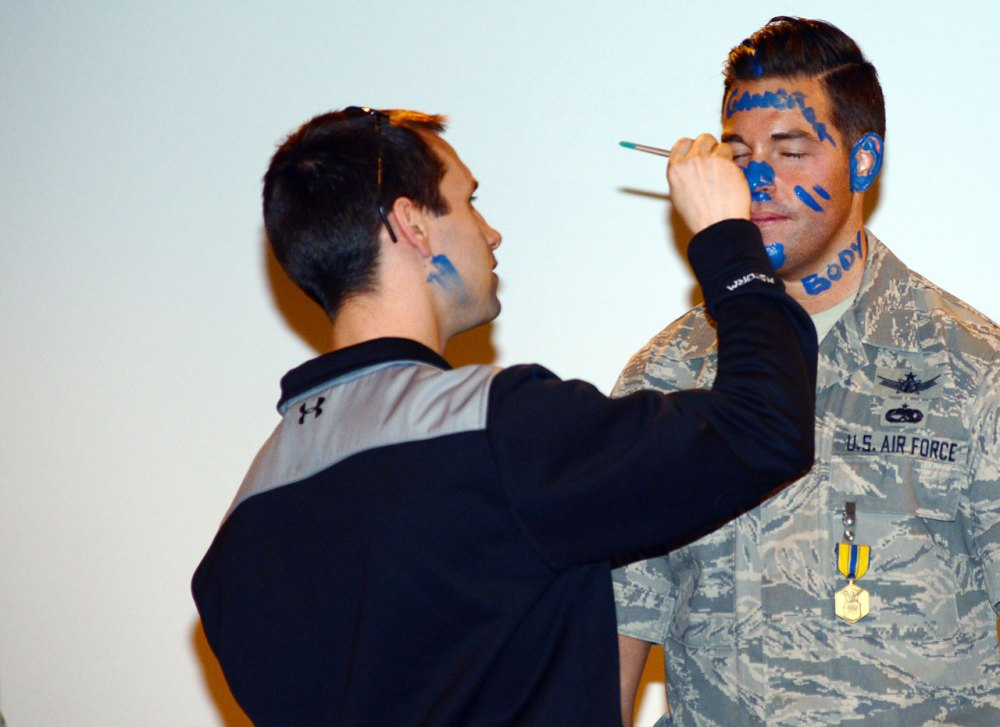 THULE AIR BASE, Greenland – Master Sgt. Christopher Boyd's face is painted as part of a 12th Space Warning Squadron Blue Nose ceremony in July 2015. The 12th SWS ceremony is unique in that it is a small affair and instead of a Blue Nose, all unit members paint a blue mark signifying their individual goodbye message. (U.S. Air Force photo by Tech. Sgt. Jared Marquis)