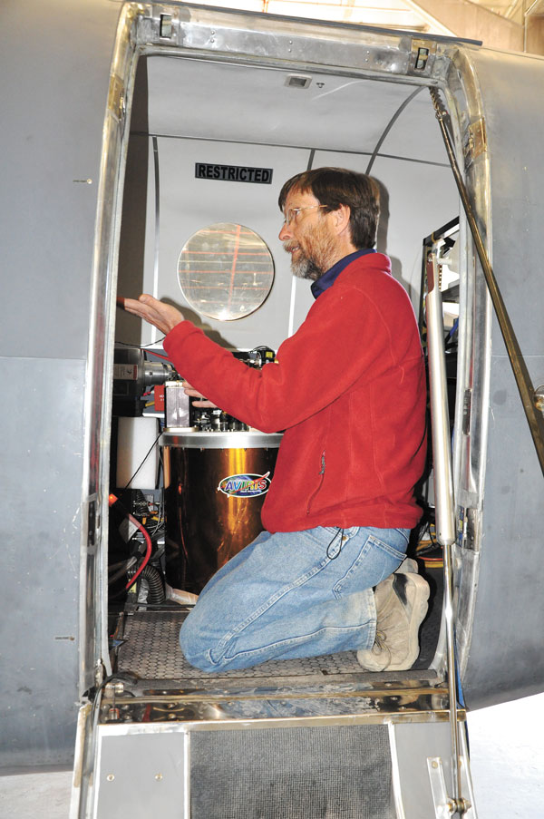 THULE AIR BASE, Greenland — Robert Green, a scientist and senior research engineer with NASA's Jet Propulsion Laboratory, explains the AVIRIS imaging spectrometer Aug. 16, 2015 at Thule Air Base. The spectrometer was used to measure the ice sheet covering Greenland to develop software for ICESat-2 due to launch in 2017. The researchers relied on the 821st Air Base Group to provide a hangar, lodging, meals and more while they conducted three weeks of research in the Arctic Circle. The 821st ABG, one of the six installations operated by the 21st Space Wing, maintains an airfield and 10,000-foot runway at the U.S. Armed Forces' northernmost installation. (U.S. Air Force photo by Steve Brady)