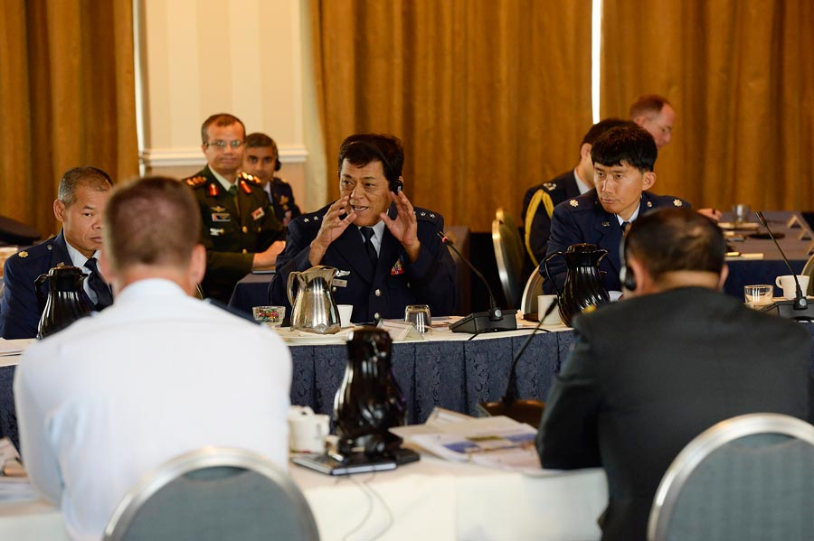 (Photo by Jim Varhegyi) PETERSON AIR FORCE BASE, Colo. — Lt. Col. Brett Chung, 21st Dental Squadron, (right) served as a translator and cultural awareness expert as he helped liaise with Gen. Saitoh (center), Chief of Staff, Japanese Air-Self Defense Force during the 2015 Pacific Air Chiefs Symposium on Sept. 10-20. In addition to the U.S. and Japan, there were eight other partner nations who participated in the symposium.