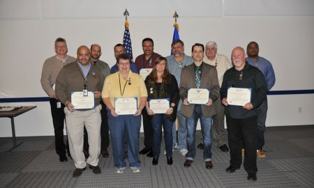Courtesy photo National Oceanic and Atmospheric Administration personnel earned Meritorious Civilian Service and Exemplary Civilian Service Awards during a ceremony Tuesday, Jan. 5, 2016, at Suitland, Maryland. They were recognized for a variety of accomplishments, from the launch of DMSP Flight-19 to ushering a 19-year-old satellite past 100,000 operational orbits, all while achieving a more than 99 percent mission success rate for the constellation.