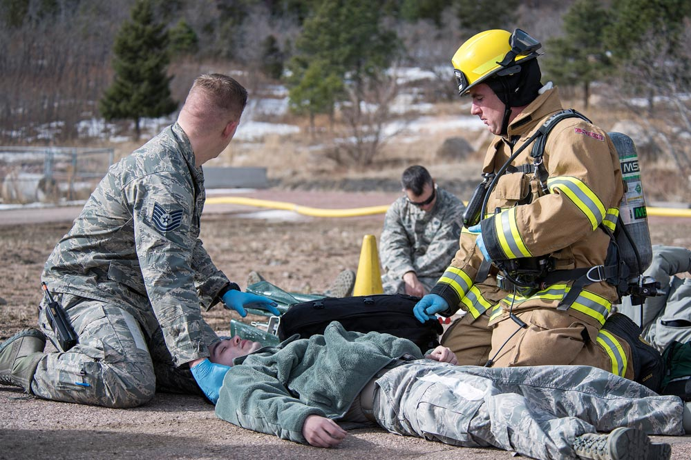 PETERSON AIR FORCE BASE, Colo. — Cheyenne Mountain Air Force Station firefighters respond to a simulated helicopter crash at CMAFS during the 16-2 Condor Crest Exercise on Feb. 19, 2016. The exercise tested the 21st Space Wing and associate units' response to several incidents during the week-long exercise.