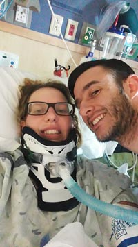 (Courtesy photo) Staff Sgt. Velette Webb, 21st Dental Squadron, and fiancé Staff Sgt. Charlie Britt, 35th Logistics and Readiness Squadron, take time for a selfie during her recovery at Craig Hospital. The photo was taken about a month after Webb suffered a mountain biking accident that left her paralyzed from the waist down.