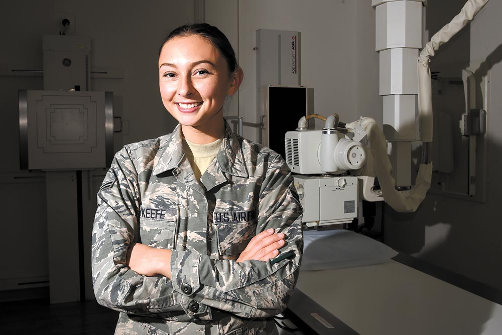 (U.S. Air Force photo by Airman 1st Class Dennis Hoffman) Peterson Air Force Base, Colo. — Airman 1st Class Rachael O'Keefe, 21st Medical Support Squadron radiology technologist, has been in the Air Force the shortest amount of time in her office but she doesn't let that stop her dedicated professionalism and eagerness to serve patients at Peterson Air Force Base, Colo. O'Keefe is one of 10 radiology technologists on base.