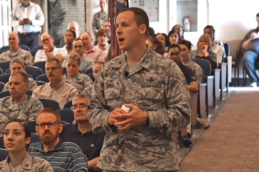 (U.S. Air Force photo by Robb Lingley) PETERSON AIR FORCE BASE, Colo. - Col. Todd Moore, 21st Space Wing commander, held his first commander's call in the base auditorium at Peterson Air Force Base, Colo., July 21, 2017. Moore projected his vision for the future of the wing to fellow Airmen.