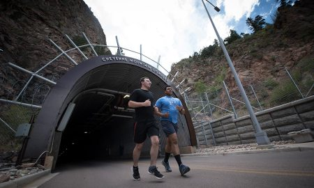 Runners participating in the North American Aerospace Defense Command 5k Tunnel Run exit the Cheyenne Mountain Complex through the north portal at Cheyenne Mountain Air Force Station, Colorado, May 10, 2018. Cheyenne Mountain relies on communications equipment sustained by Air Force Life Cycle Management Center personnel at Peterson Air Force Base, Colorado. (U.S. Air Force photo by Senior Airman Dennis Hoffman)