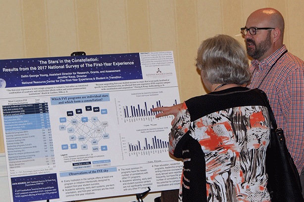 Dallin Young conversing with an attendee at the Poster Session