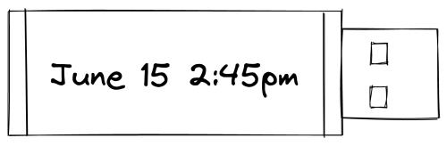 "USB flash drive labeled ""June 15 2:45pm"""
