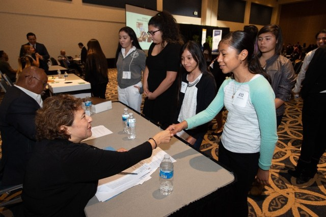A student presents to Rossina Gallegos from MUFG Union Bank, N.A. Photo credit: Matt Petit for MUFG Union Bank, N.A.