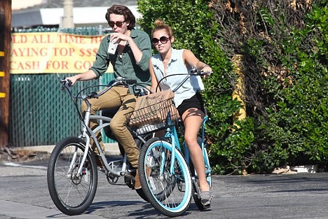 Miley Cyrus on her Pedego Electric Bike