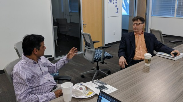 BDS Global Capital Managing Partner Bennett Marks (right) discussing startups with an attendee at Bennett's talk at the CSUF Startup Incubator