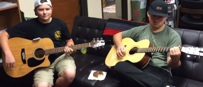 Crosstimbers Academy Students Playing Guitar