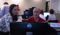 Rebecca Meader assists CCS's Rod Ramer