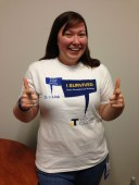 """SBCTC's Tamara Allen sports her """"I survived User Acceptance Testing"""" tee. As a Student Financials Functional Analyst, Tamara participated in UAT and was a lucky recipient of one of TCC's memorable tees (courtesy of Andy Duckworth). Notice it also includes Testing Lead Maureen Avery's famous quote, """"Testing is NOT Training."""""""