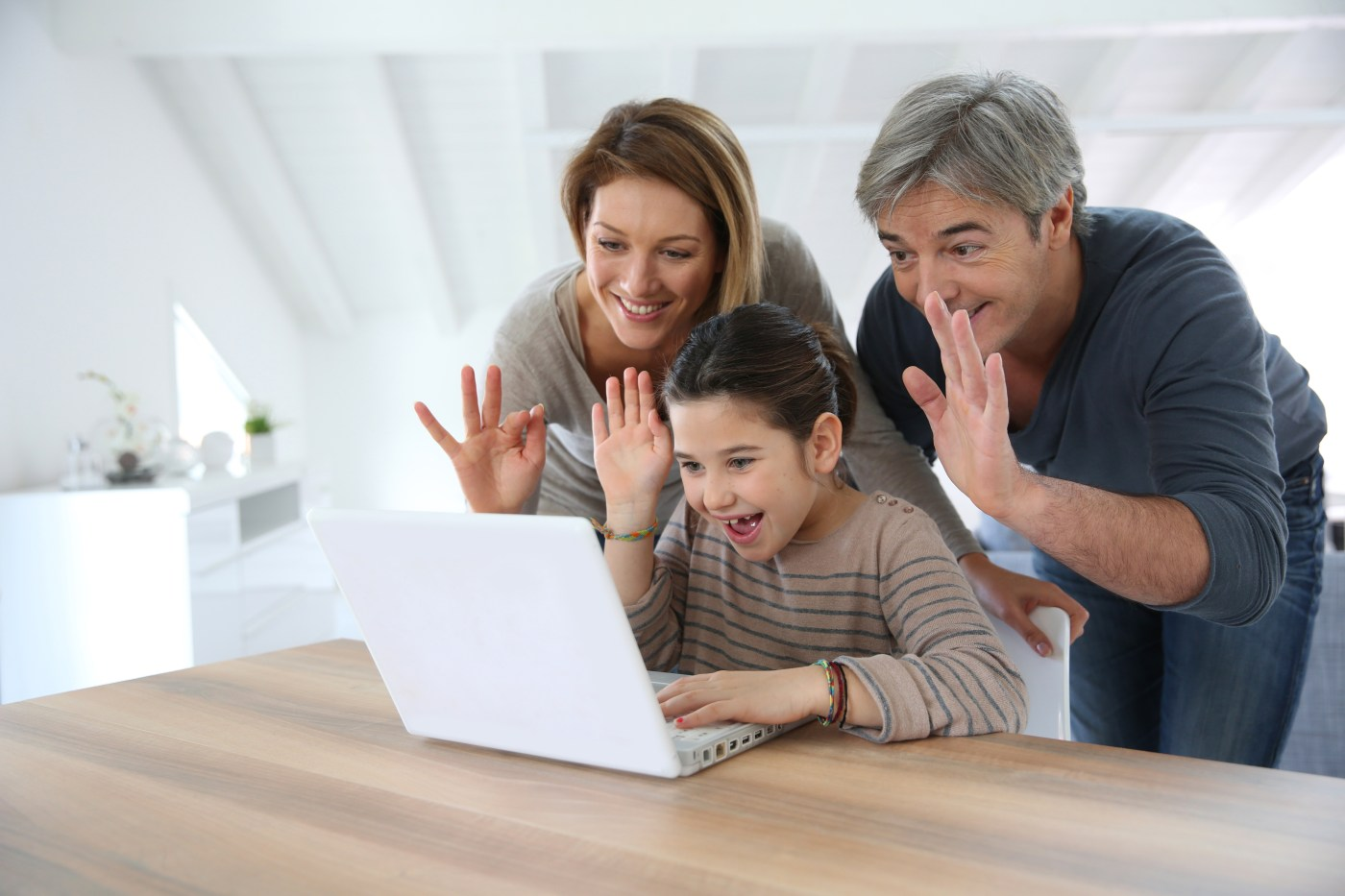 Family Waving at Computer Screen on Call